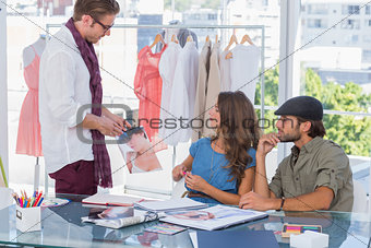 Attractive designer showing a picture