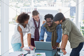 Creative designers working on a laptop