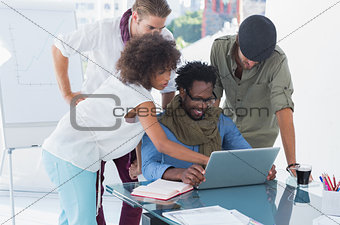 Creative designers using laptop