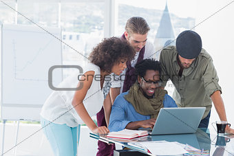 Attractive designers working in office at desk