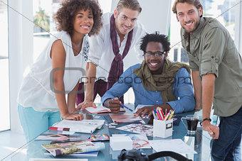 Designers smiling at camera