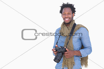 Attractive photographer holding camera