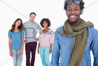 Fashion man standing in front of others young people