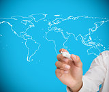Businessman drawing world map