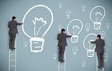 Multiple businessmen on ladders drawing light bulbs