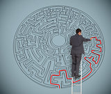 Businessman drawing red line to solve a maze