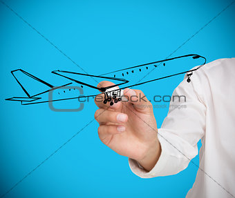 Businessman drawing black airplane