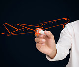 Buisnessman drawing orange airplane