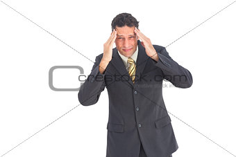 Anxious businessman with hands on his head
