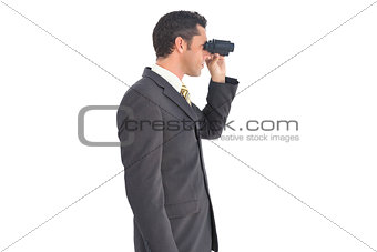 Businessman with binoculars looking on the right