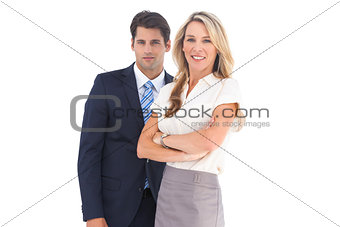 Businessman and woman looking at the camera