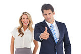 Businessman with thumb up and his smiling coworker