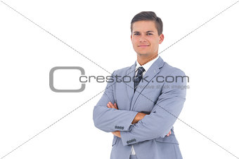 Smart businessman with arms crossed