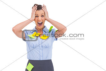 Businesswoman shouting with adhesive notes on her shirt