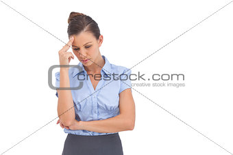 Pretty businesswoman thinking with closed eyes