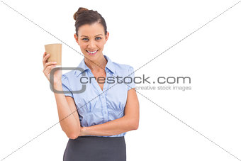 Attractive businesswoman holding coffee cup