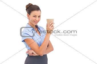 Classy businesswoman holding coffee cup