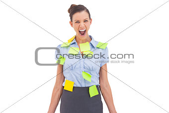 Businesswoman covered with sticky notes