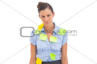 Upset businesswoman with adhesive notes