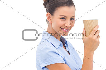 Attractive businesswoman holding a coffee cup