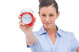 Businesswoman showing alarm clock