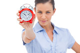 Businesswoman holding alarm clock