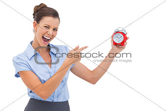 Businesswoman indicating alarm clock