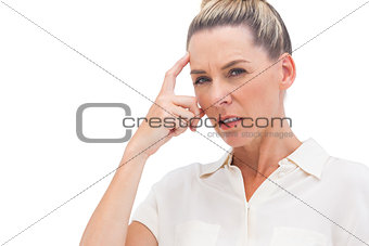Businesswoman thinking with hand on forehead