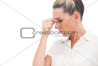 Businesswoman pinching nose