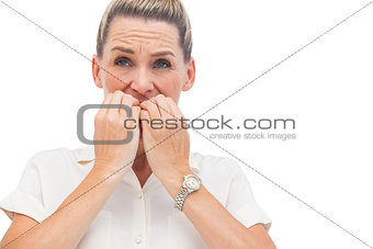 Anxious businessman biting nails