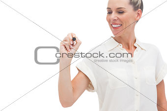 Smiling businesswoman looking at pen in her hand