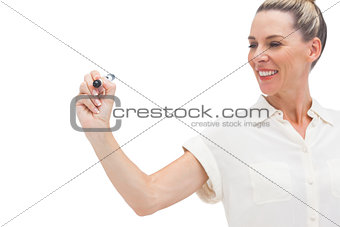 Smiling businesswoman looking at marker in her hand