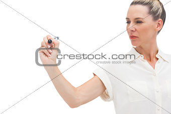 Serious businesswoman looking at pen in her hand
