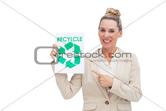 Smiling businesswoman promoting recycling and environment