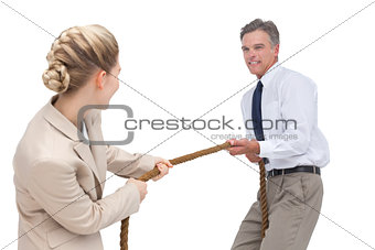 Business people competing in pulling rope