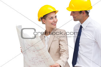 Architect team looking at each other with construction plan