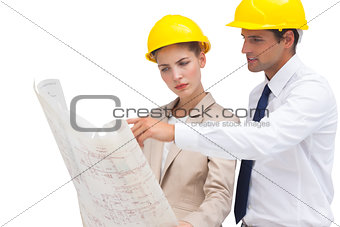 Serious architects looking at construction plan