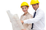 Architects with construction plan and yellow helmets