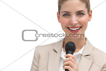 Classy businesswoman holding microphone