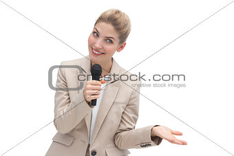 Amazed businesswoman speaking on microphone