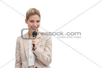 Stylish businesswoman holding microphone