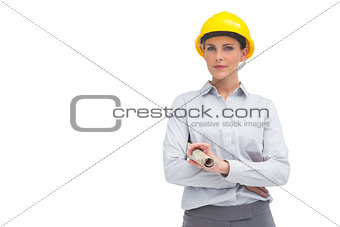Architect with yellow helmet and rolled up plan