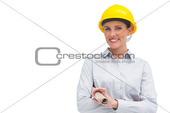 Smiling architect holding rolled up plan