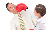 Businesswoman knocking out a businessman with boxing gloves