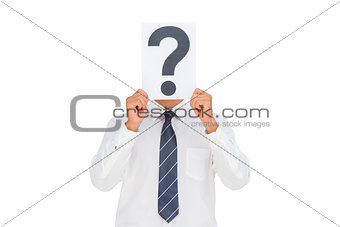 Businessman holding a paper with a question mark over face
