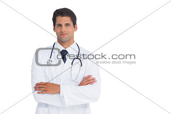 Attractive doctor smiling with arms crossed