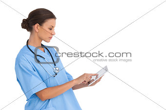 Surgeon working on digital tablet