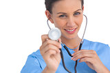 Happy surgeon holding up stethoscope