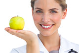 Nurse with apple in her hand