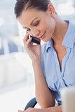 Happy businesswoman calling